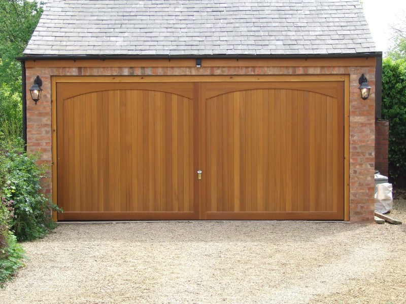 Double Woodrite Chartridge Cedar wood timber door with softwood timber sub frame on detached brick garage