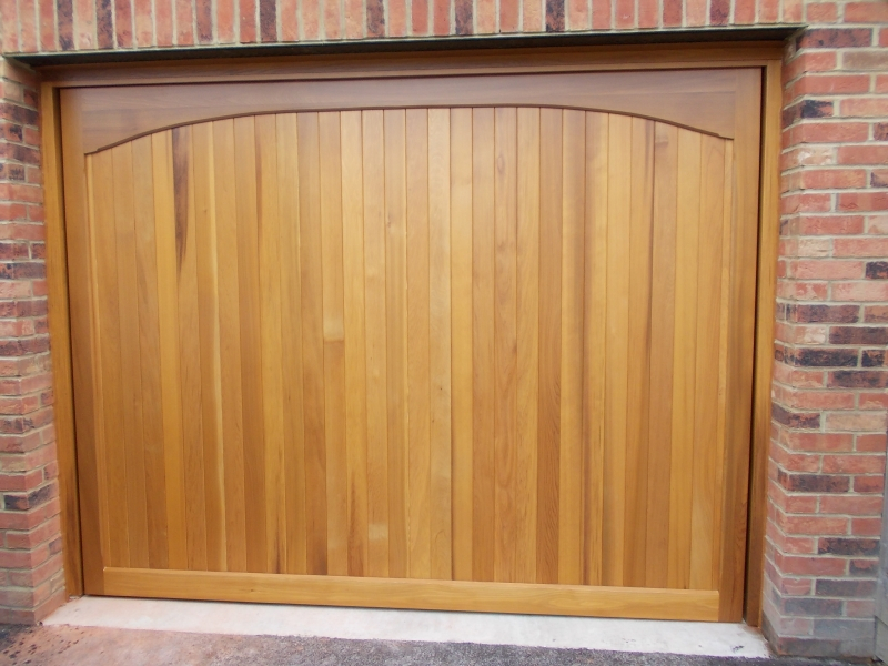 Woodrite Chartridge Cedar wood timber door installed behind single integral brick garage