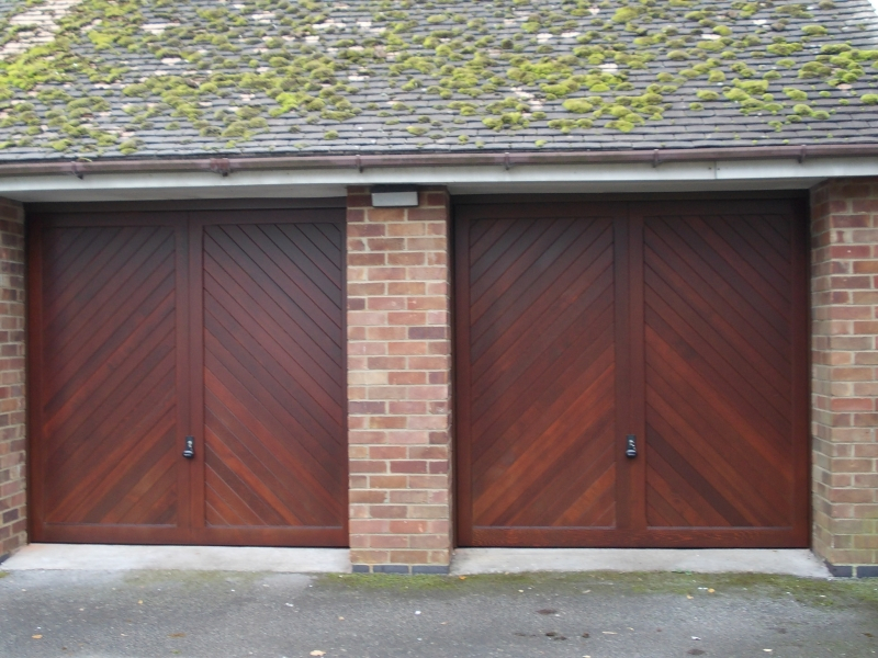 Twin Woodrite Burnham Cedar wood timber doors installed behind openings on integral brick garage