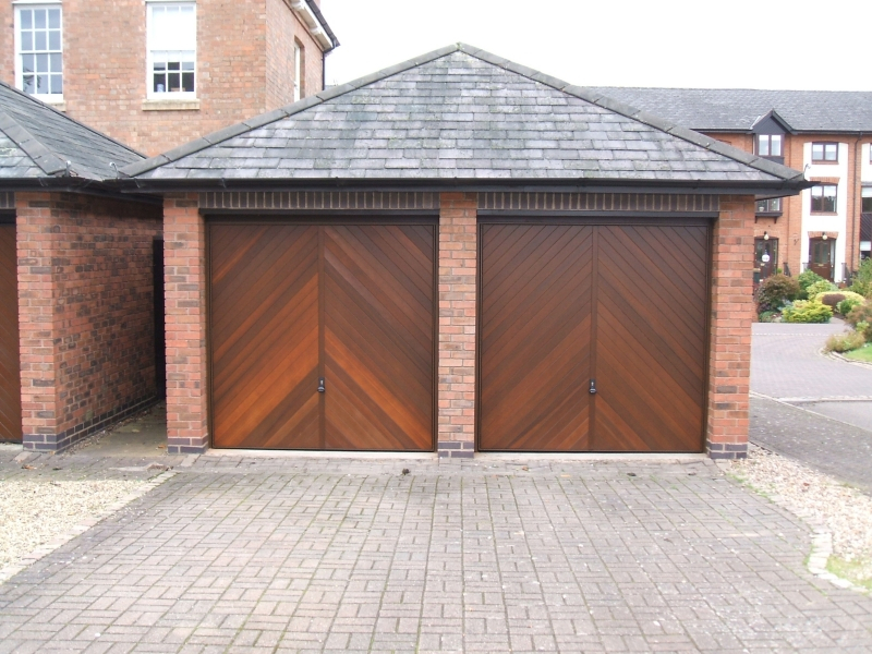 Twin Woodrite Chesham Cedar wood timber doors installed behind openings on detached brick garage