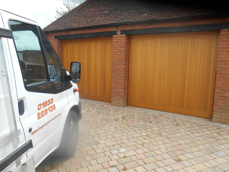 Woodrite Chartridge Cedar wood timber doors installed behind twin detached brick garage