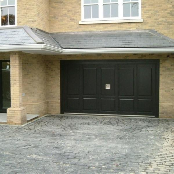 Silvelox big with pedestrian door silvelox bespoke doors for Oversized garage doors